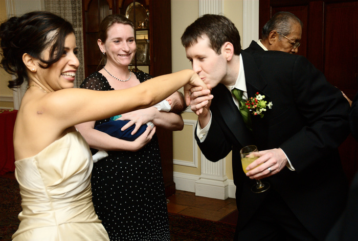 Bride getting hand kissed by wedding guest | Washington DC Wedding Photographer, Ben Rasmussen Photography